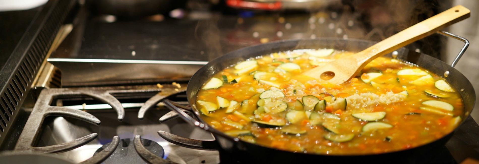Pan of veggies on a black stove
