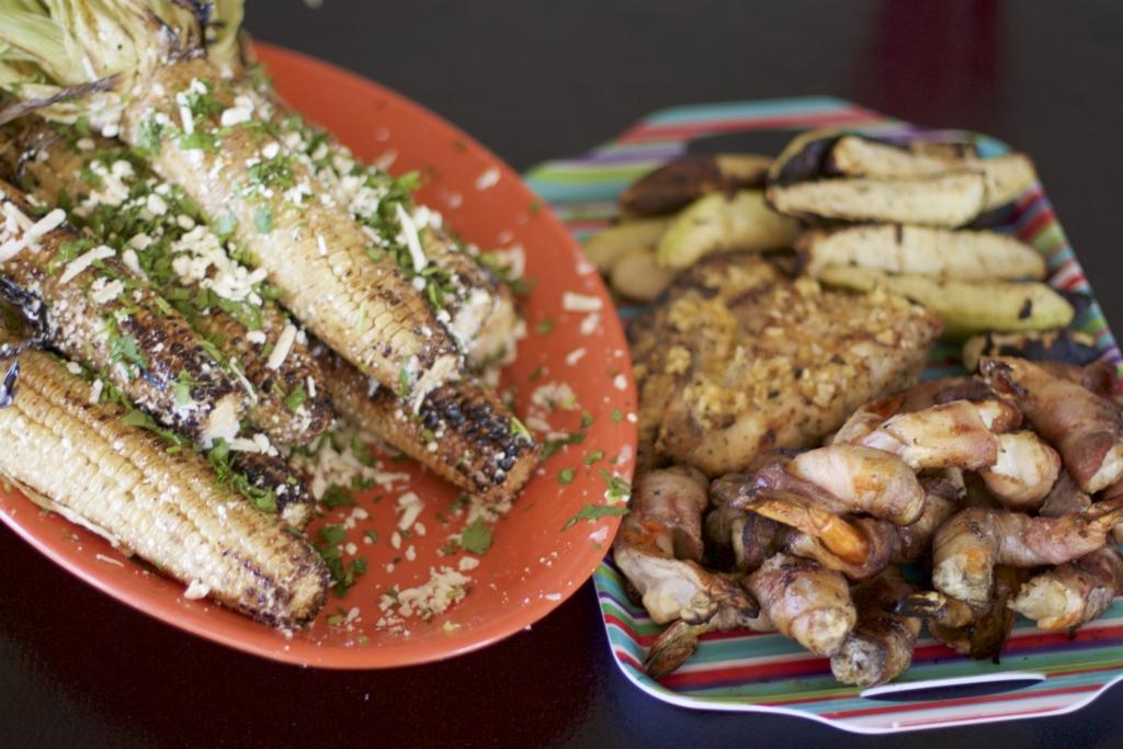 Corn on the cob, shrimp, and zucchini