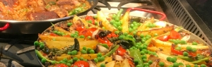 Pan of paella sitting on a stove top